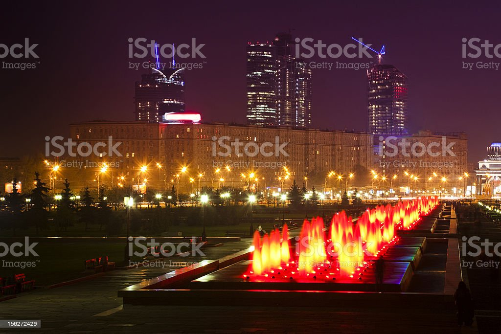 Moscow night skyline with city park fountain in foreground royalty-free stock photo