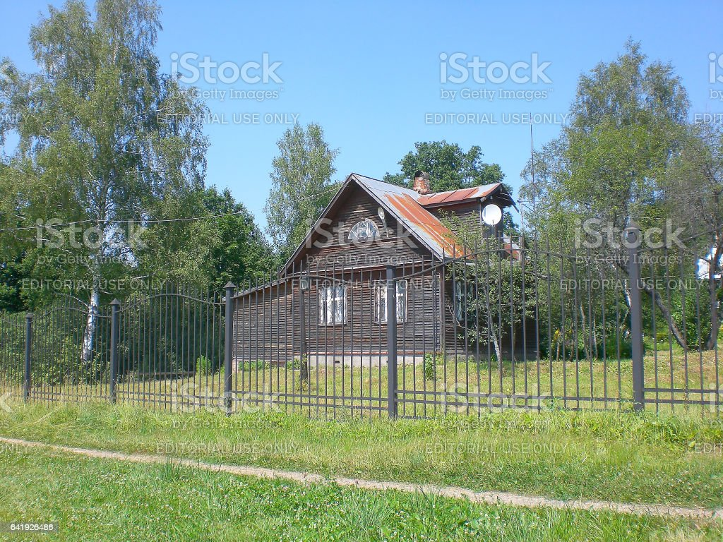 Moscow region, Russia – July 17, 2010: The house in village behind a fence, Moscow Region stock photo