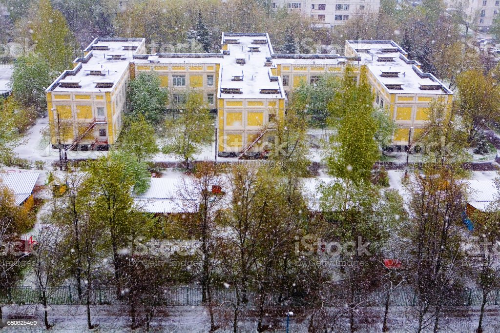 Moscow, Russia, May 8, 2017: A natural phenomenon. Unexpected spring snowfall. stock photo