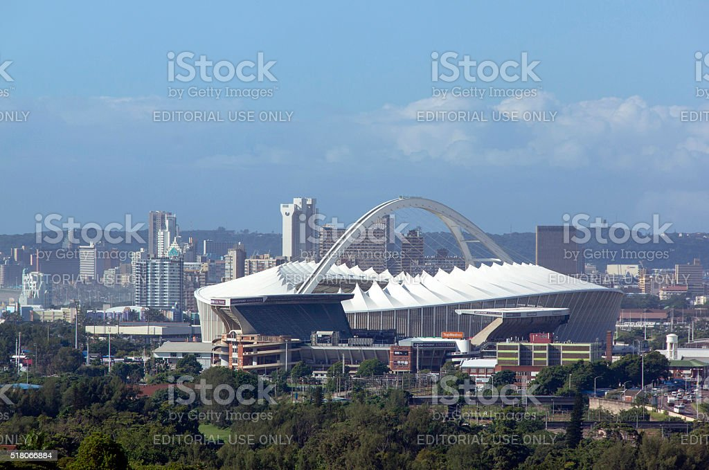 Moses Mabhida Stadium with Durban Skyscrapers in Background stock photo