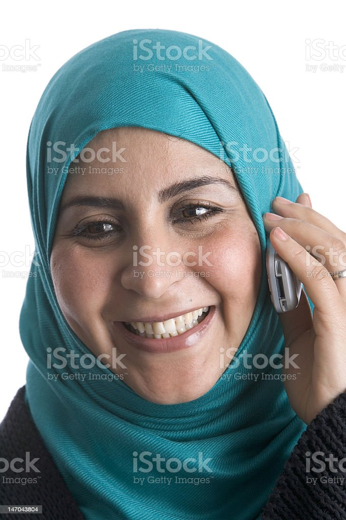 Moslim woman with a mobile phone stock photo