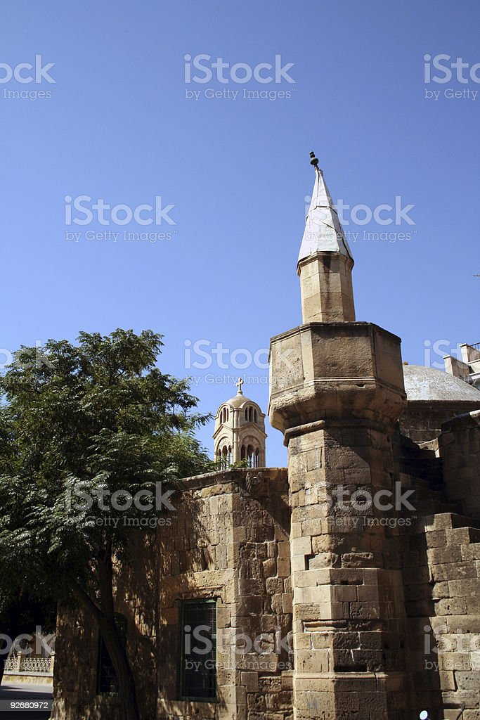 Mosque and church royalty-free stock photo
