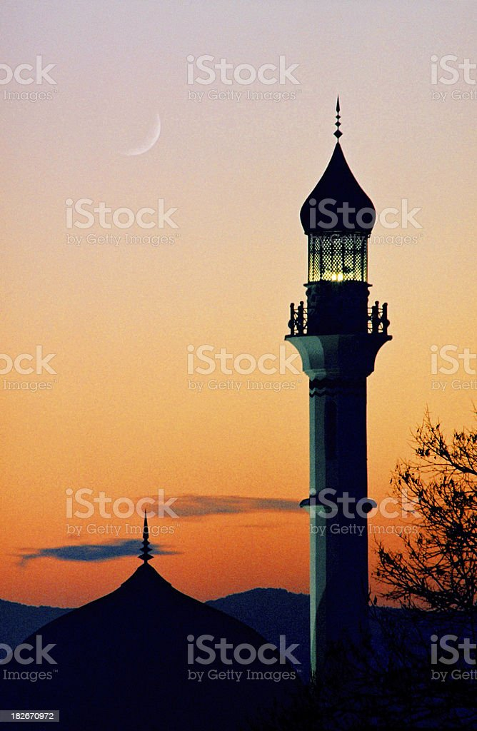 Mosque in dusk with crescent moon royalty-free stock photo