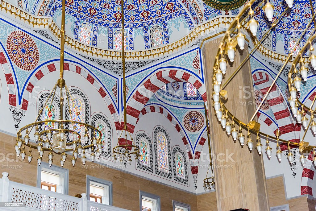 mosque interior detail from vaulted ceil stock photo