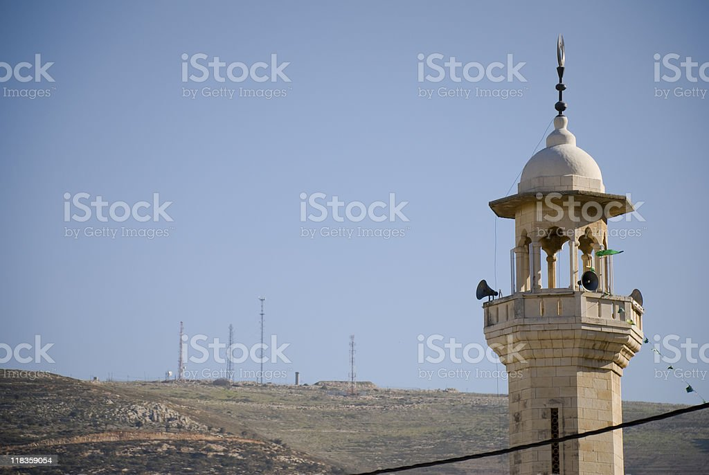Mosque and military communication towers in Nablus royalty-free stock photo