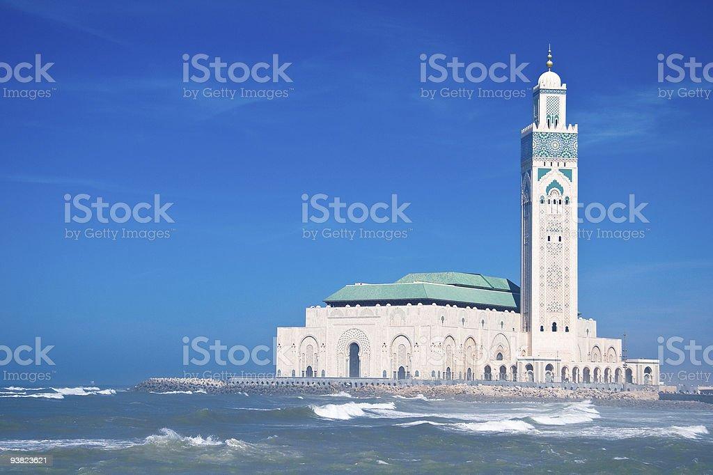 Mosque on the beach near the ocean stock photo