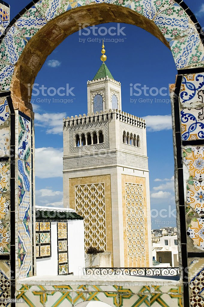 Mosque tower - framed with ornamental arch in Tunis stock photo