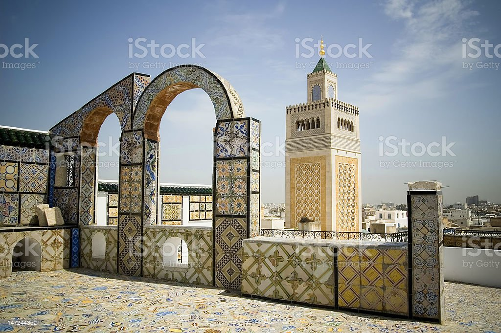 Mosque tower framed with ornamental arch in Tunis stock photo