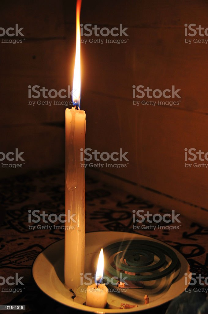mosquito coil and candles - Malaria prevention stock photo