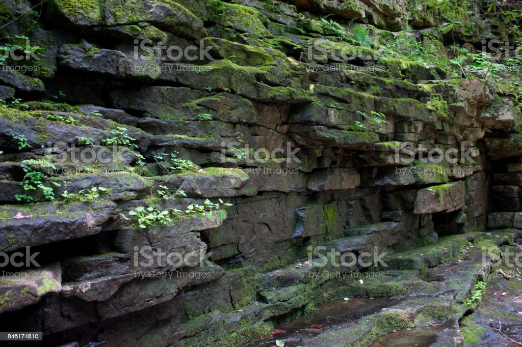 Moss covered Rock Wall stock photo