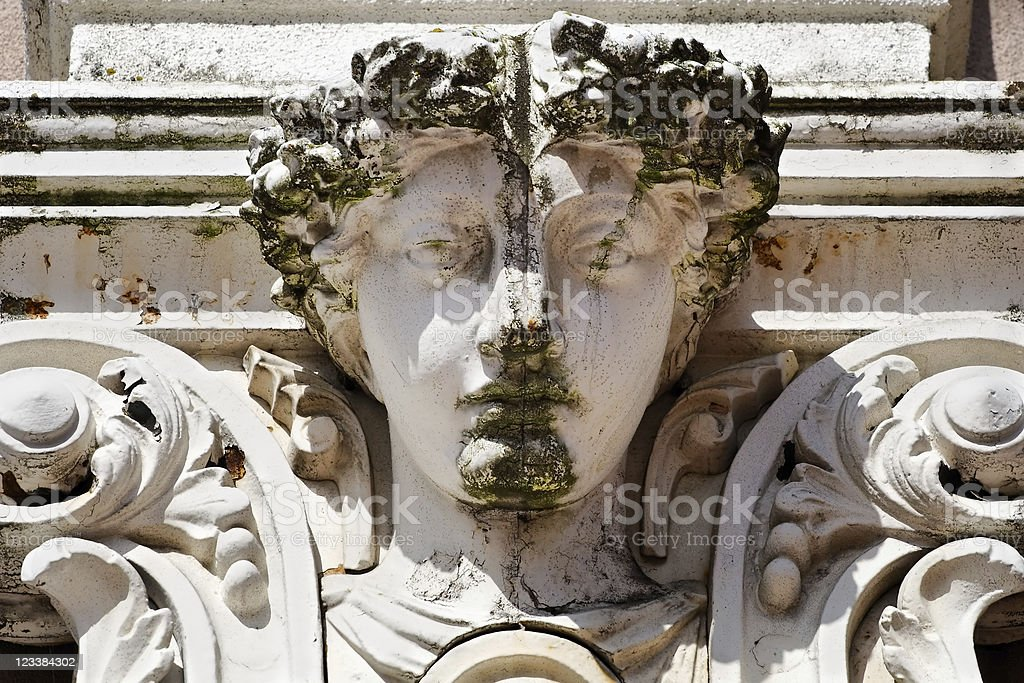 Moss covered stone face royalty-free stock photo
