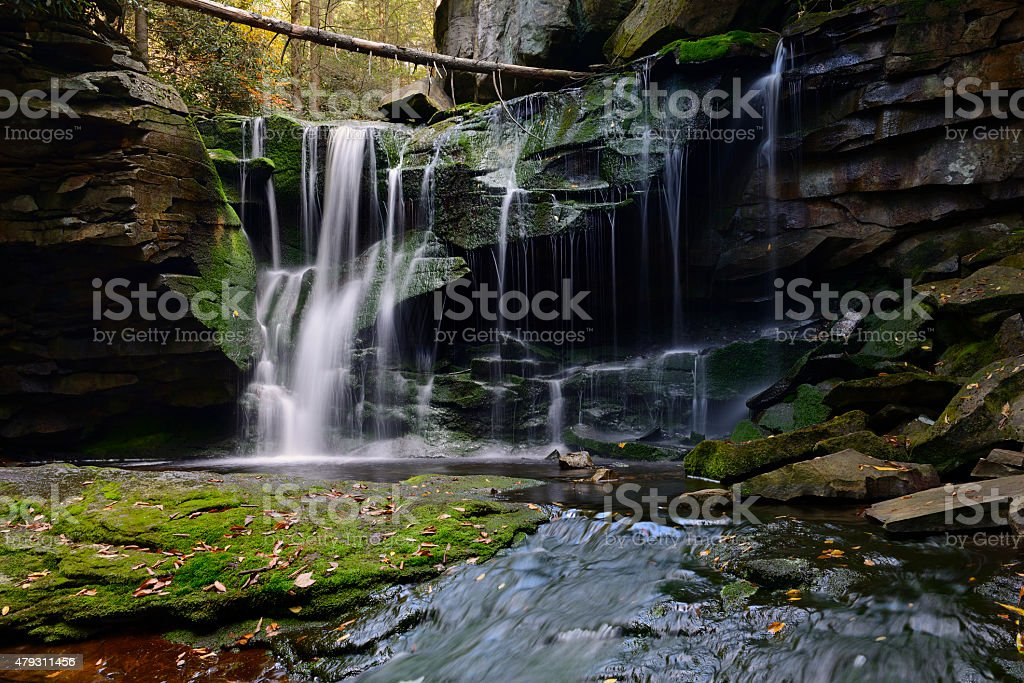 Moss Covered Waterfall in Autumn stock photo
