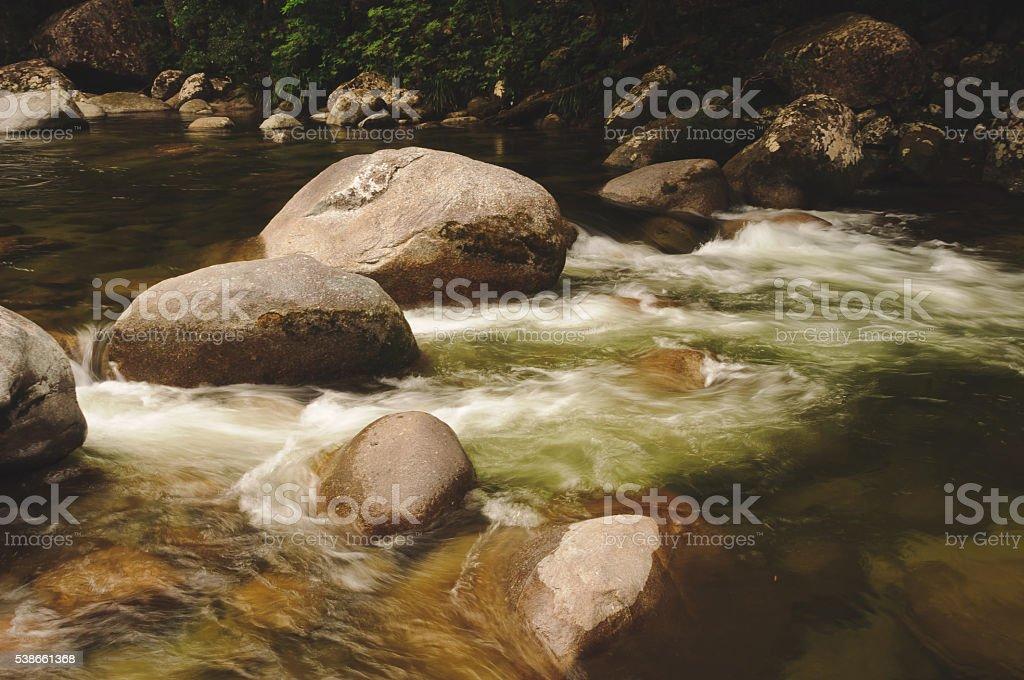 Mossman river boulders stock photo