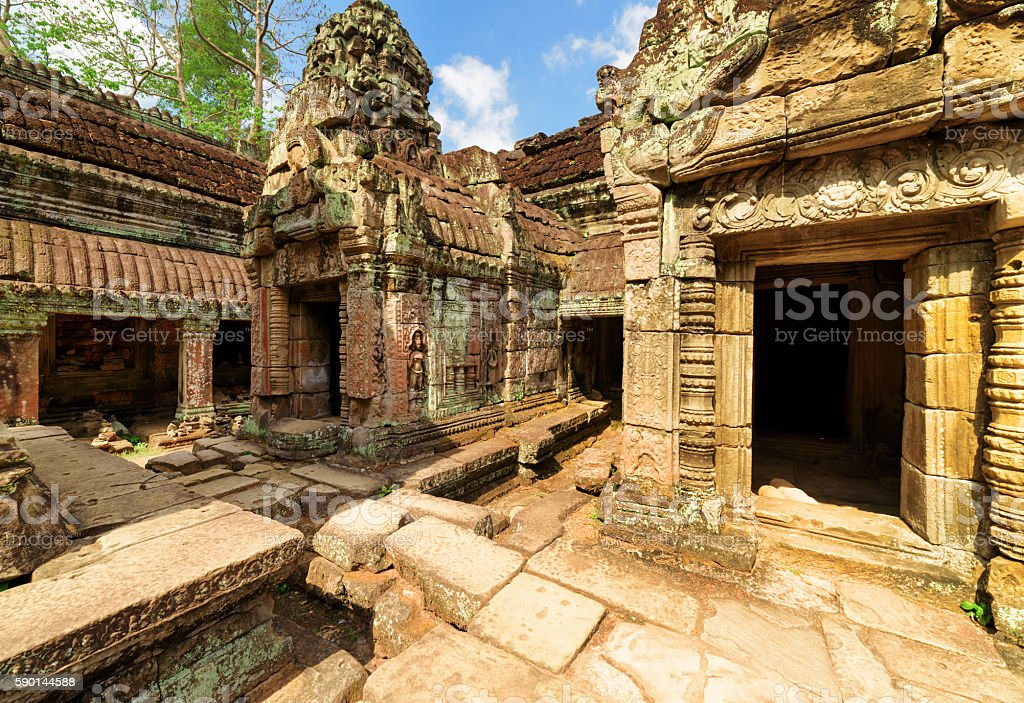 Mossy buildings with carving of ancient Preah Khan, Angkor stock photo