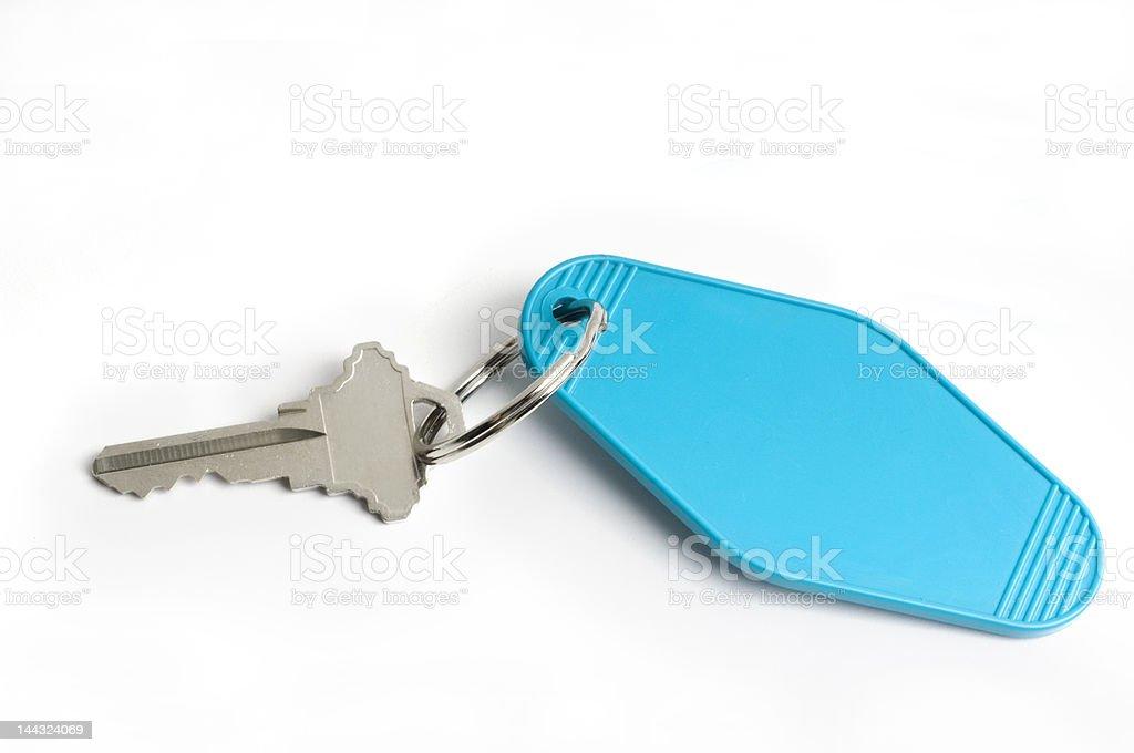 motel key on white stock photo