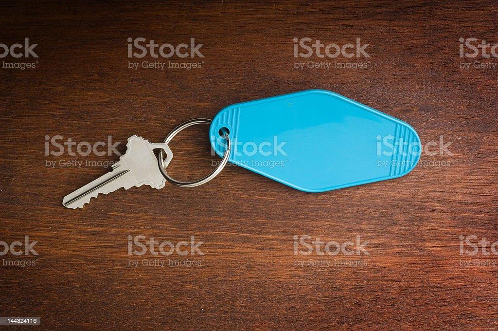 motel key on wood royalty-free stock photo