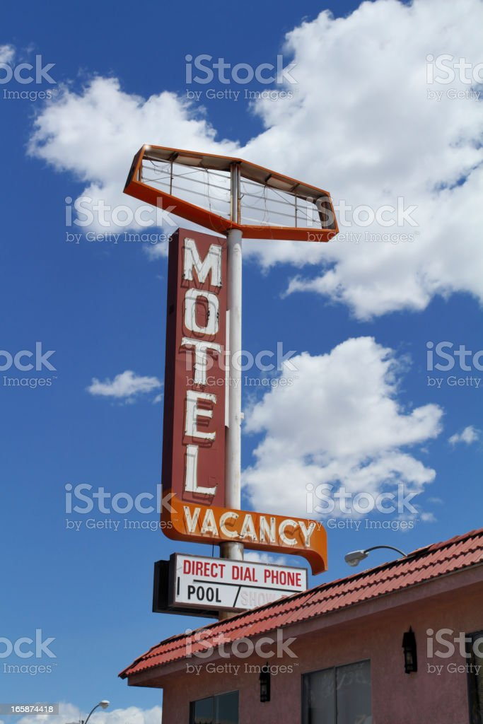 Motel sign on abandoned building stock photo