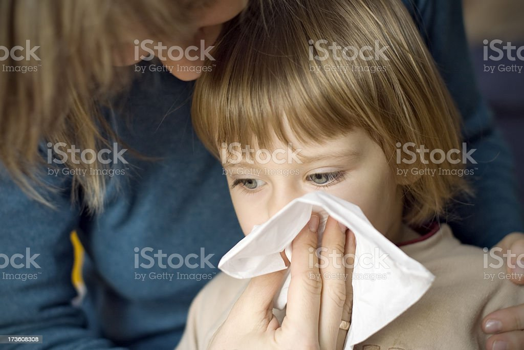 Mother and a sick girl stock photo
