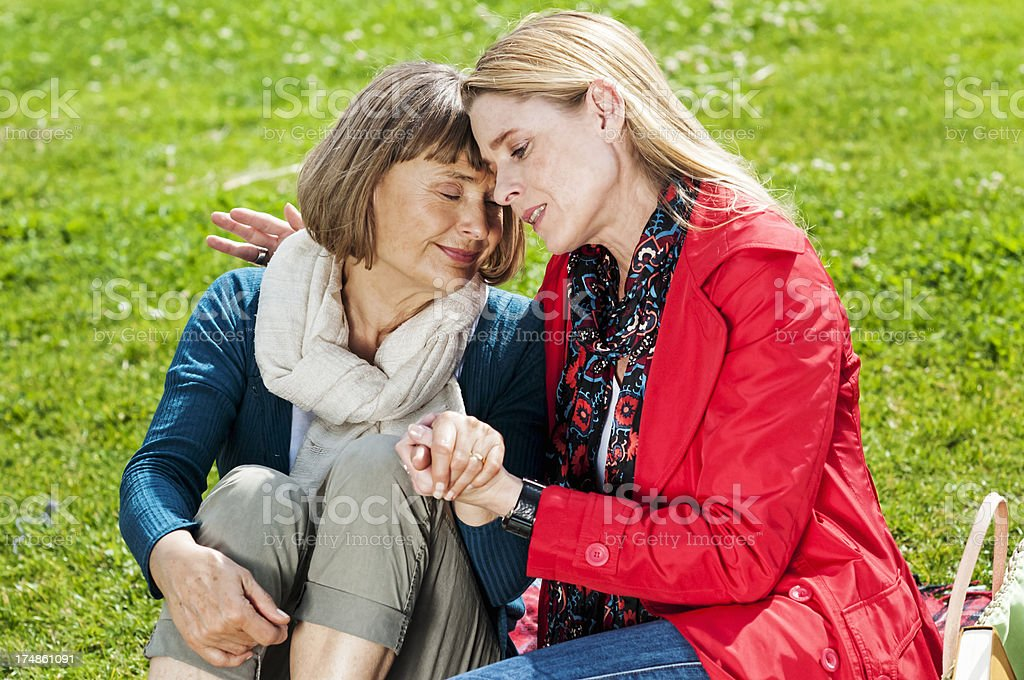 Mother and adult daughter share some bad news royalty-free stock photo