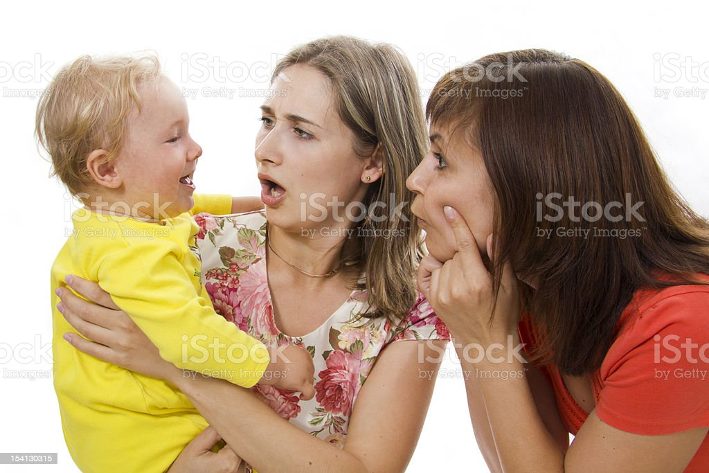 Mother and aunt have fun together with the child stock photo