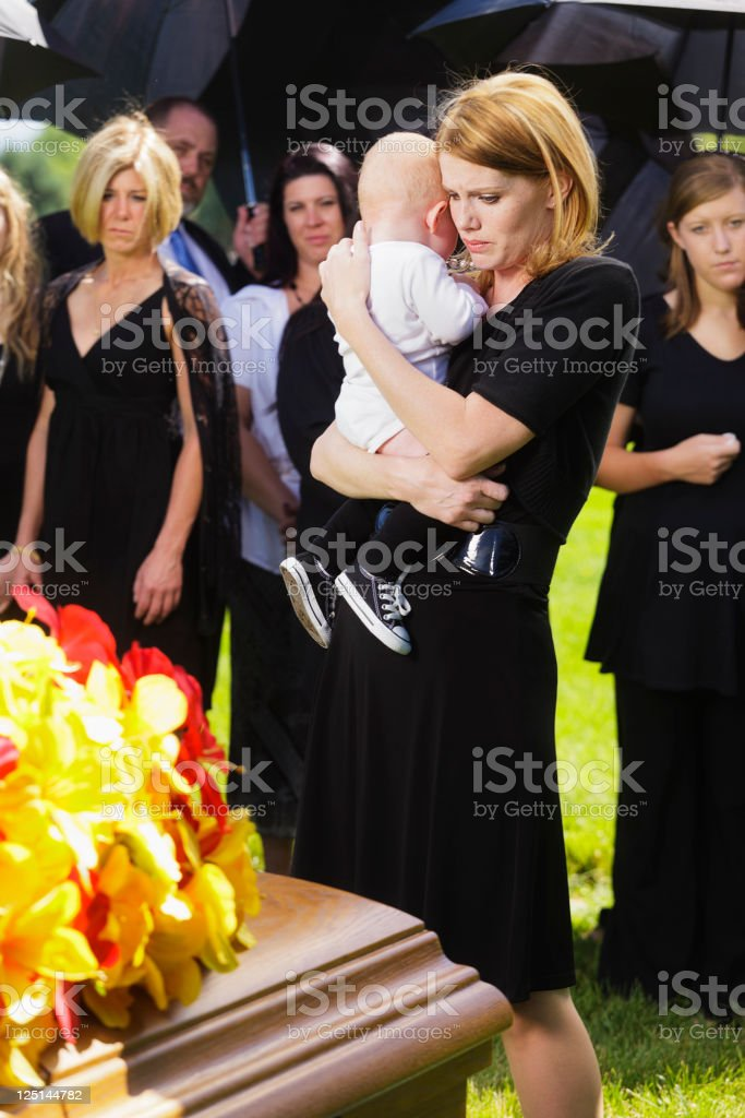 Mother and Baby at a Funeral royalty-free stock photo