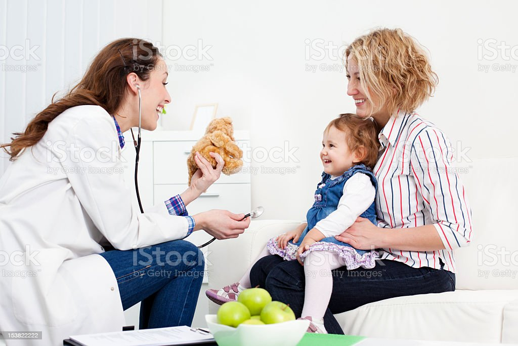 Mother and baby at doctors office royalty-free stock photo