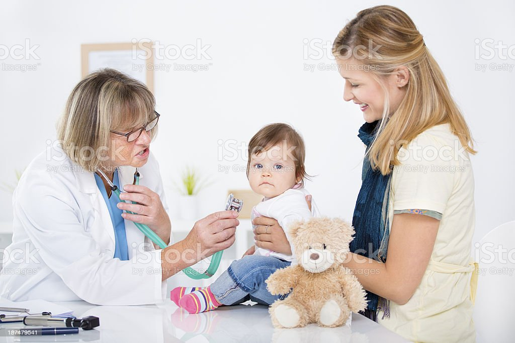 Mother and baby at doctors office. royalty-free stock photo