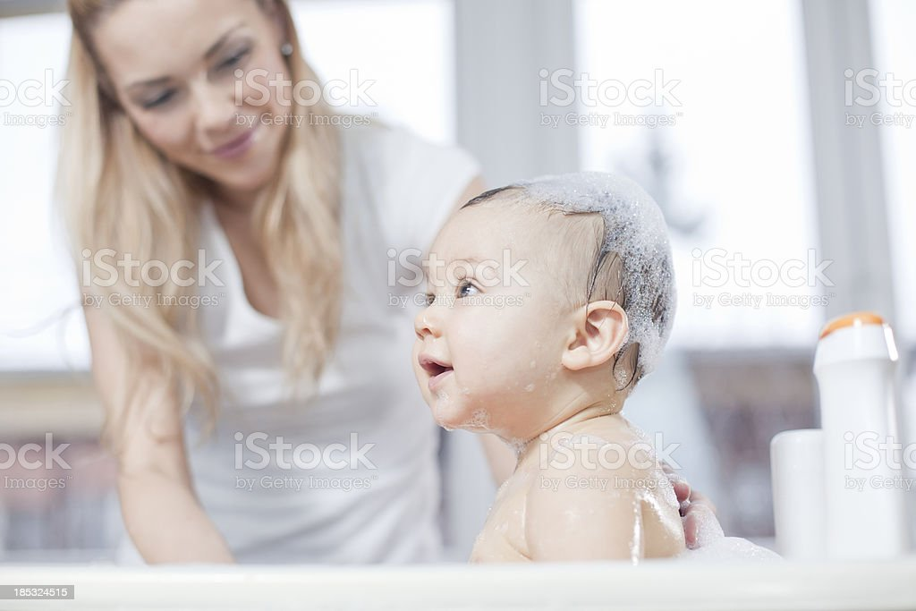 Mother and baby bath stock photo