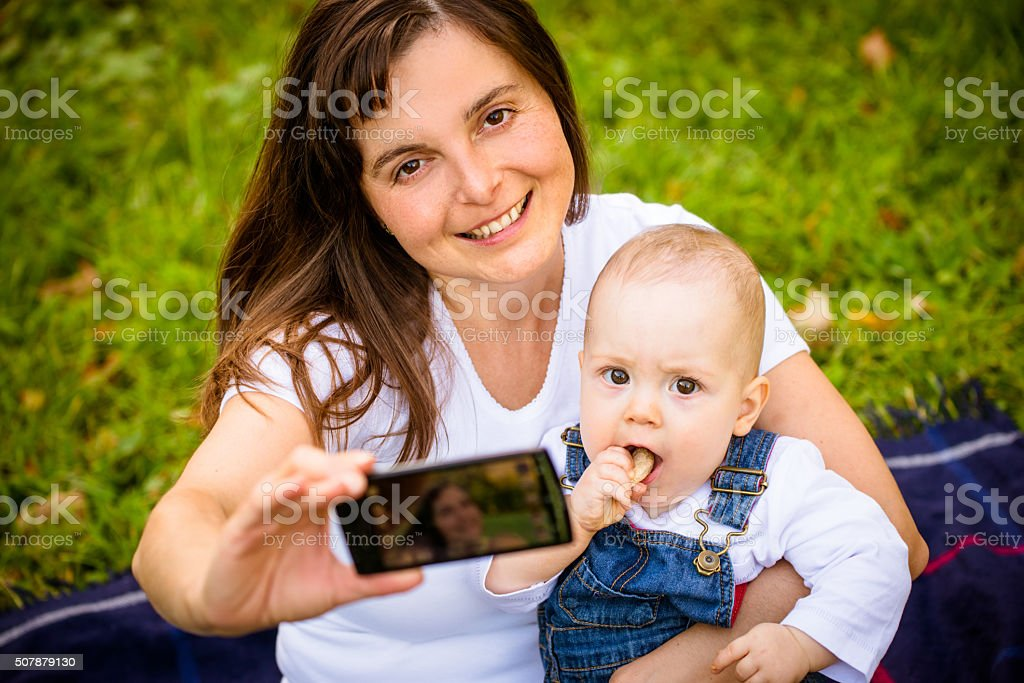 Mother and baby - capturing moments stock photo