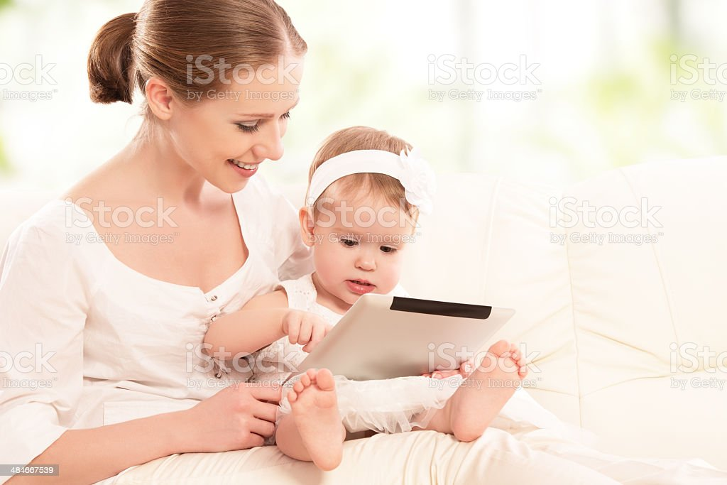 mother and baby child with tablet computer  at home royalty-free stock photo