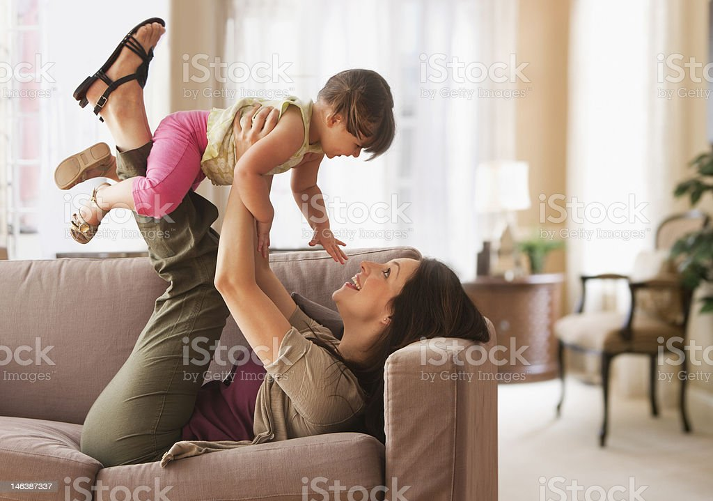 Mother and baby daughter playing stock photo