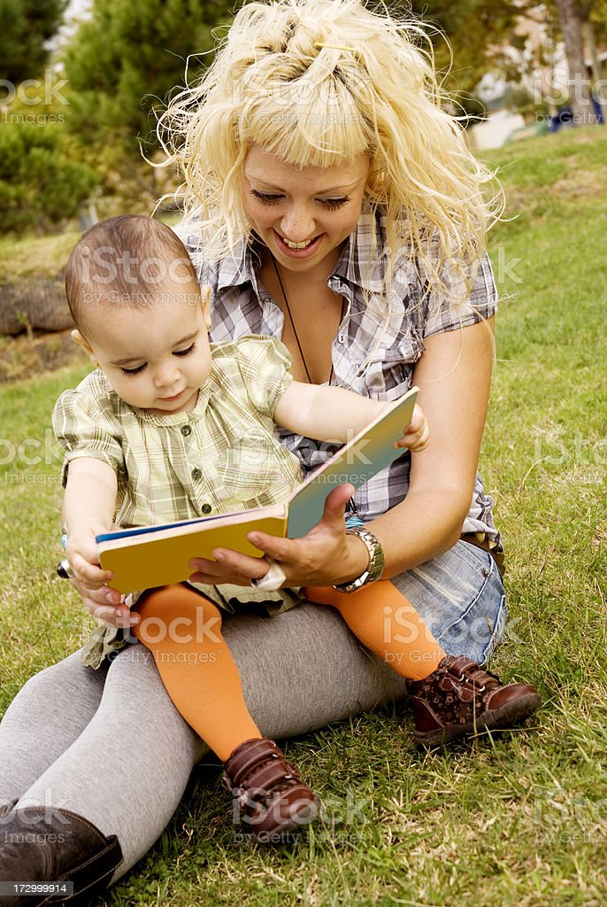 Mother and baby daugther reading royalty-free stock photo