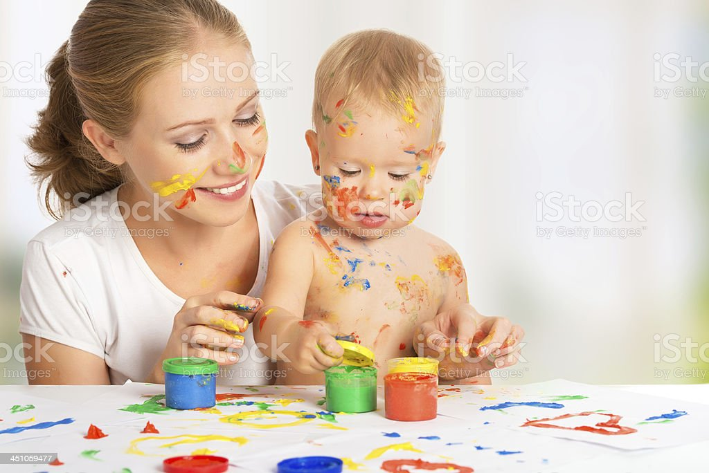 Mother and baby doing a finger painting activity royalty-free stock photo