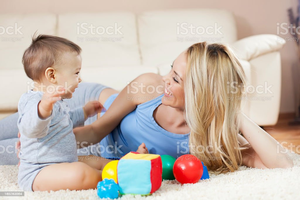 Mother and baby enjoying play time together royalty-free stock photo