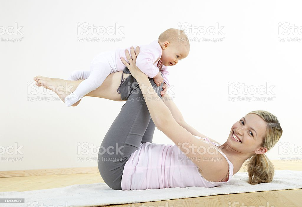 mother and baby exercise royalty-free stock photo