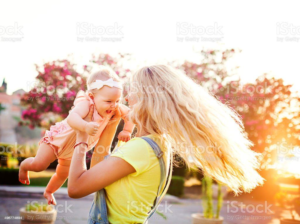 Mother and baby girl daughter outdoor fun stock photo