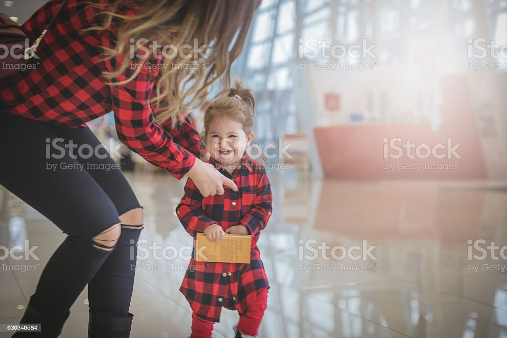 mother and baby girl having fun stock photo
