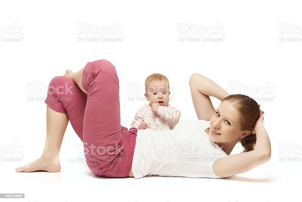 mother and baby gymnastics, yoga exercises stock photo