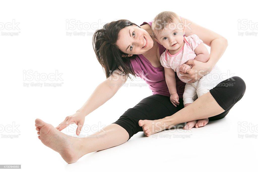 mother and baby gymnastics yoga stock photo