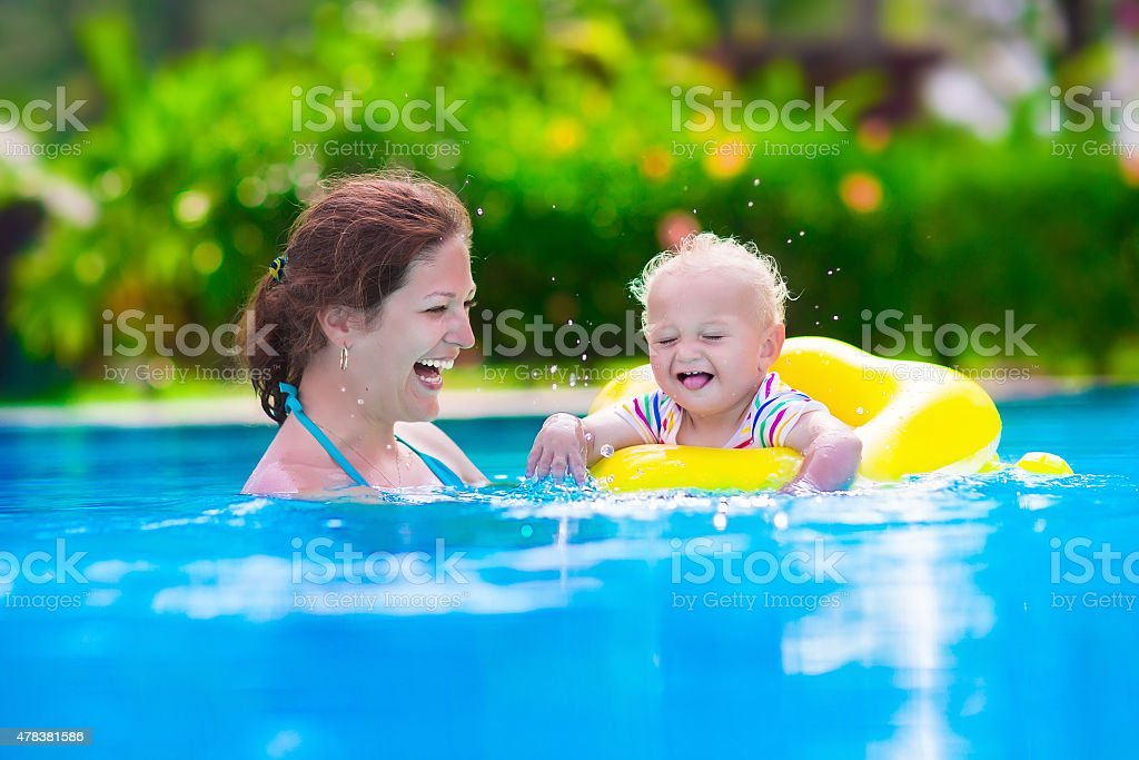 Mother and baby in a swimming pool stock photo