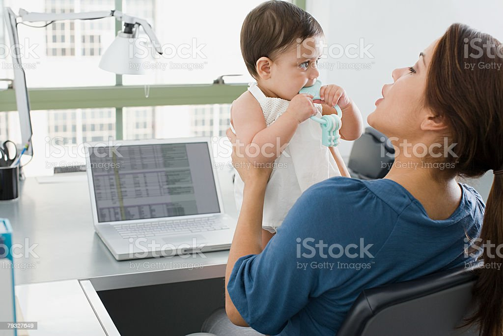 Mother and baby in an office stock photo