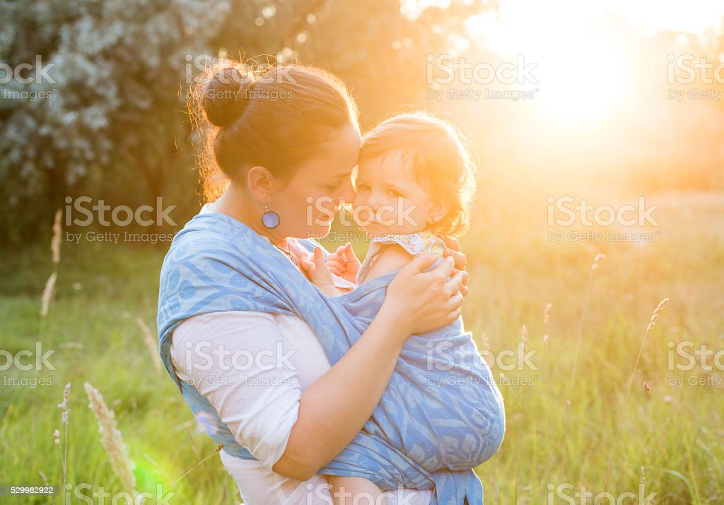 Mother and baby in sling stock photo