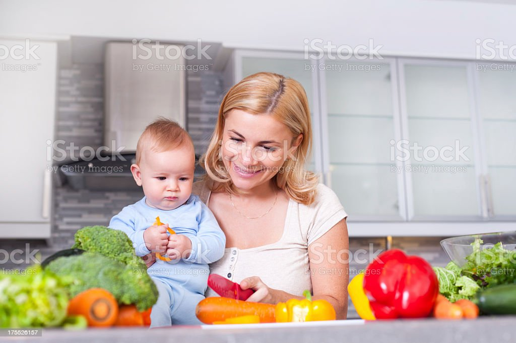 Mother and baby in the kitchen royalty-free stock photo