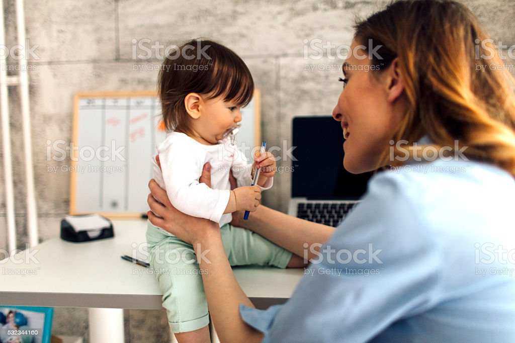 Mother And Baby In The Office stock photo
