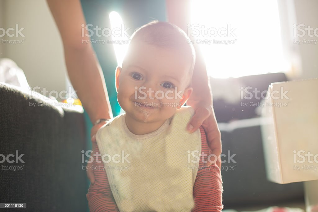 Mother and baby playing in the white livingroom stock photo