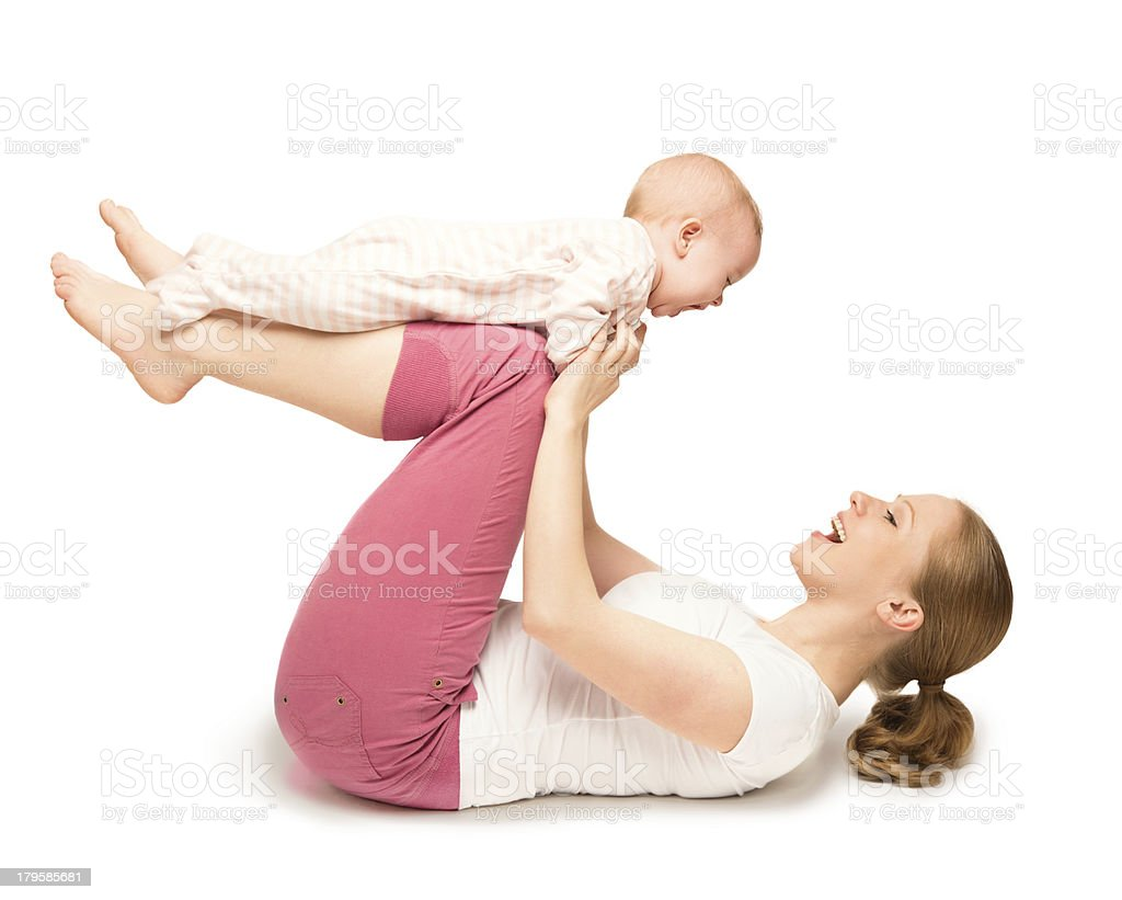 Mother and baby playing yoga and exercising royalty-free stock photo