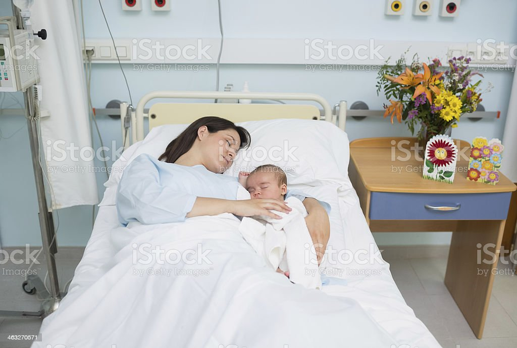 Mother and baby sleeping in the same bed royalty-free stock photo