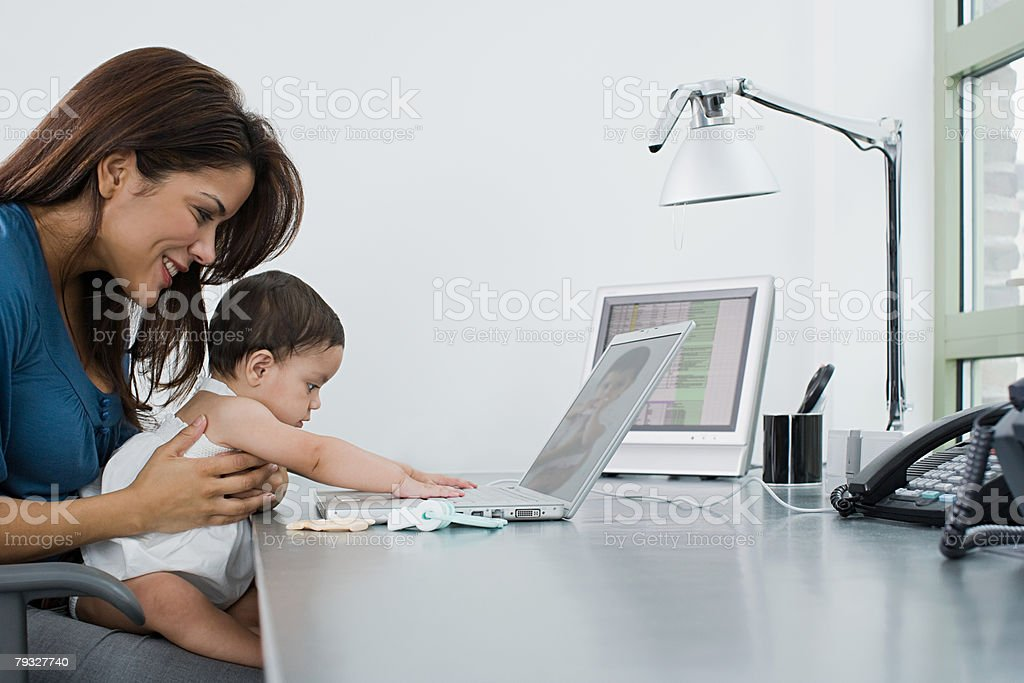 Mother and baby using a laptop computer stock photo