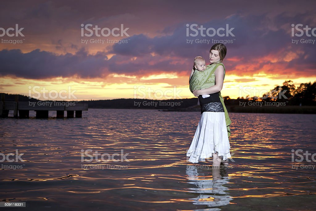 mother and babysling stock photo