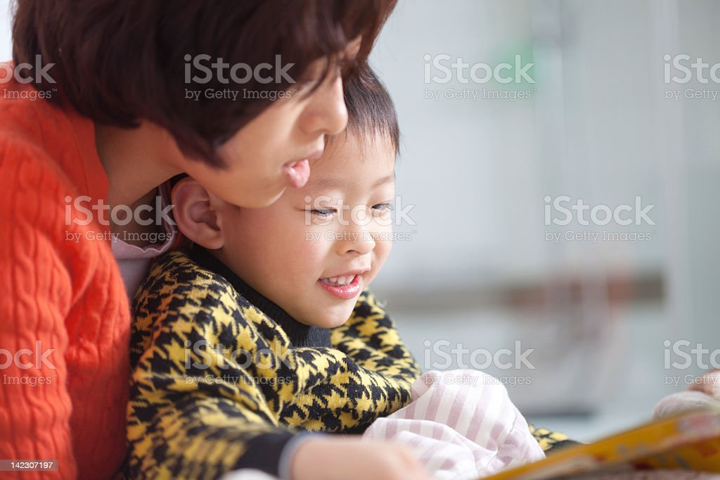 mother and boy reading book royalty-free stock photo